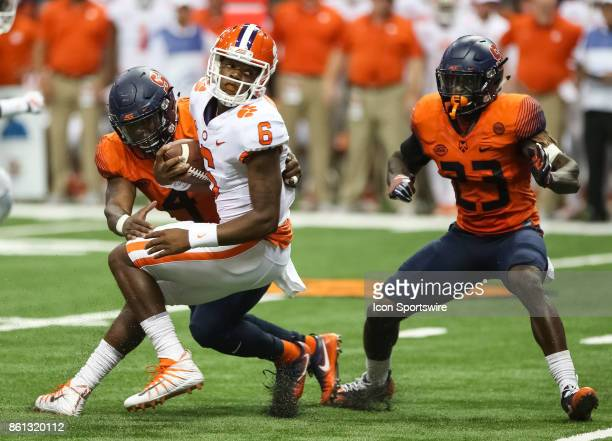Clemson Tigers quarterback Zerrick Cooper is tackled by Syracuse Orange linebacker Adam Dulka during a college football game between Clemson Tigers...
