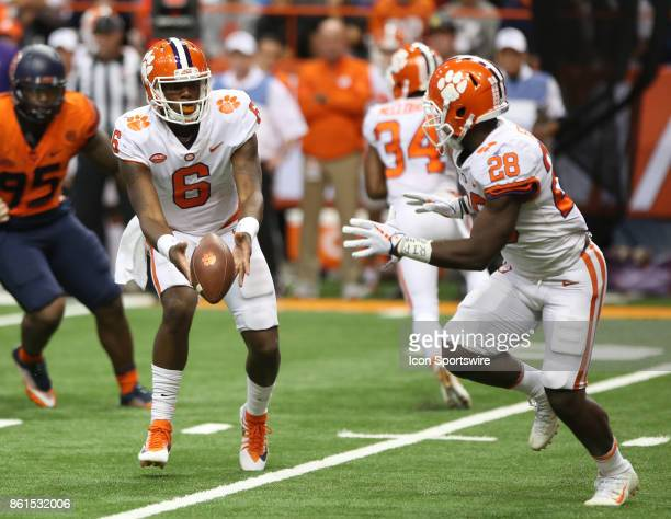Clemson Tigers quarterback Zerrick Cooper pitches the ball to Clemson Tigers running back Tavien Feaster during a college football game between...