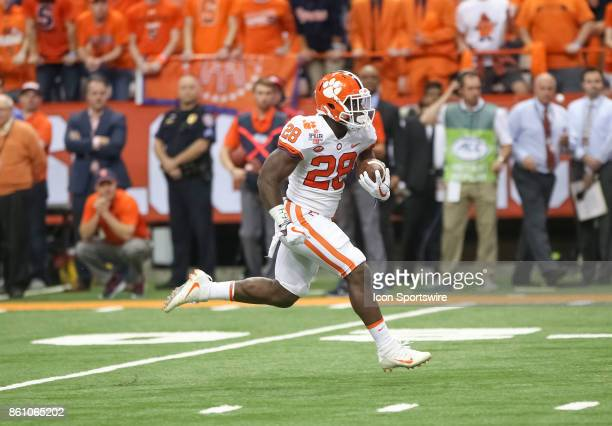 Clemson Tigers running back Tavien Feaster runs for a touchdown during a college football game between Clemson Tigers and Syracuse Orange on October...
