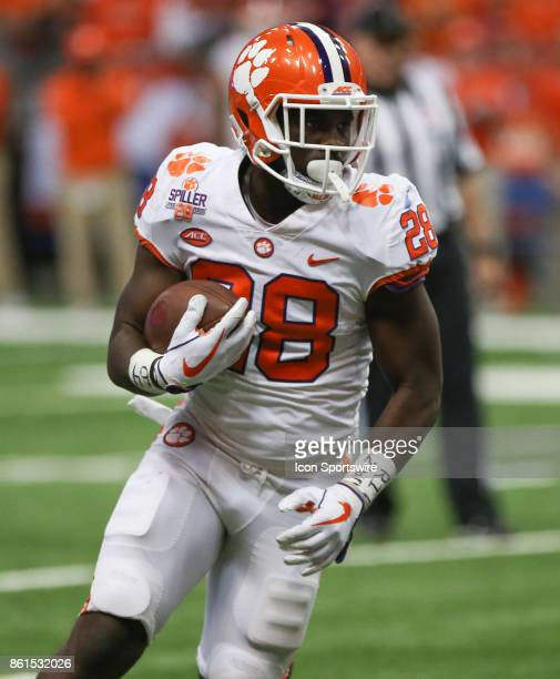 Clemson Tigers running back Tavien Feaster runs with the ball during a college football game between Clemson Tigers and Syracuse Orange on October 13...