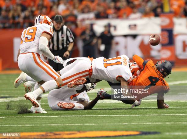 Clemson Tigers safety Isaiah Simmons jars the ball lose from Syracuse Orange running back Dontae Strickland during a college football game between...