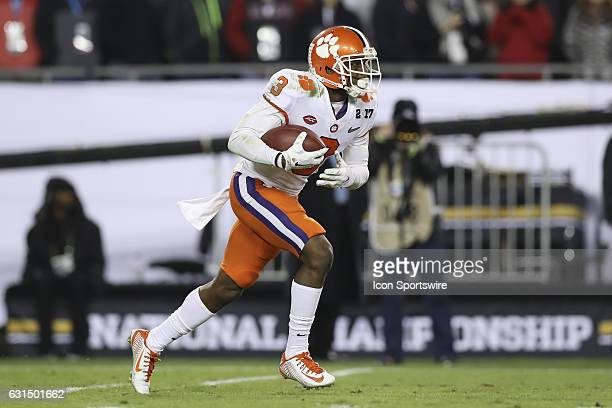 Clemson Tigers wide receiver Artavis Scott returns a kick off during the 2017 College Football National Championship Game between the Clemson Tigers...