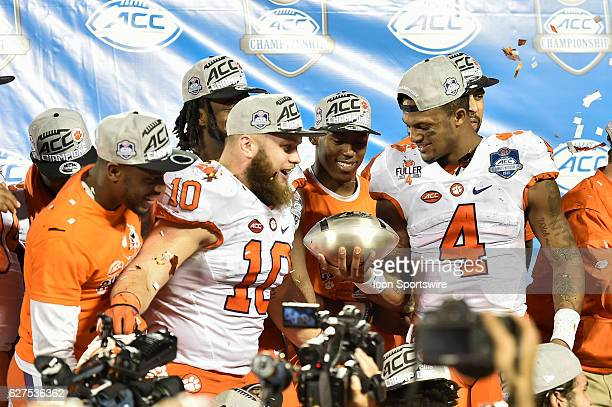 Clemson University quarterback Deshaun Watson and Clemson University linebacker Ben Boulware celebrate with the championship trophy during the award...