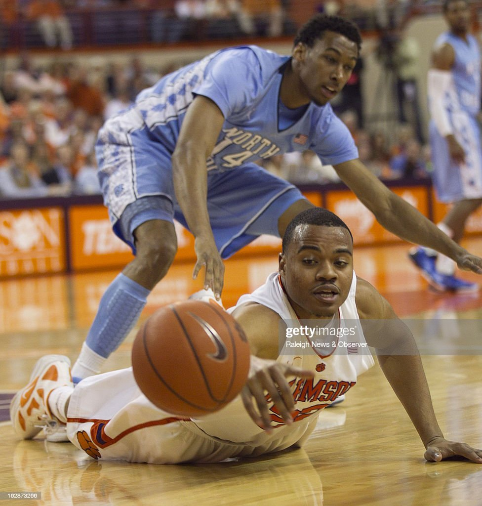 Clemson's Bernard Sullivan dives after a loose ball after getting tangled with North Carolina's Desmond Hubert, top, during the first half at Littlejohn Coliseum in Clemson, South Carolina, on Thursday, February 28, 2013.