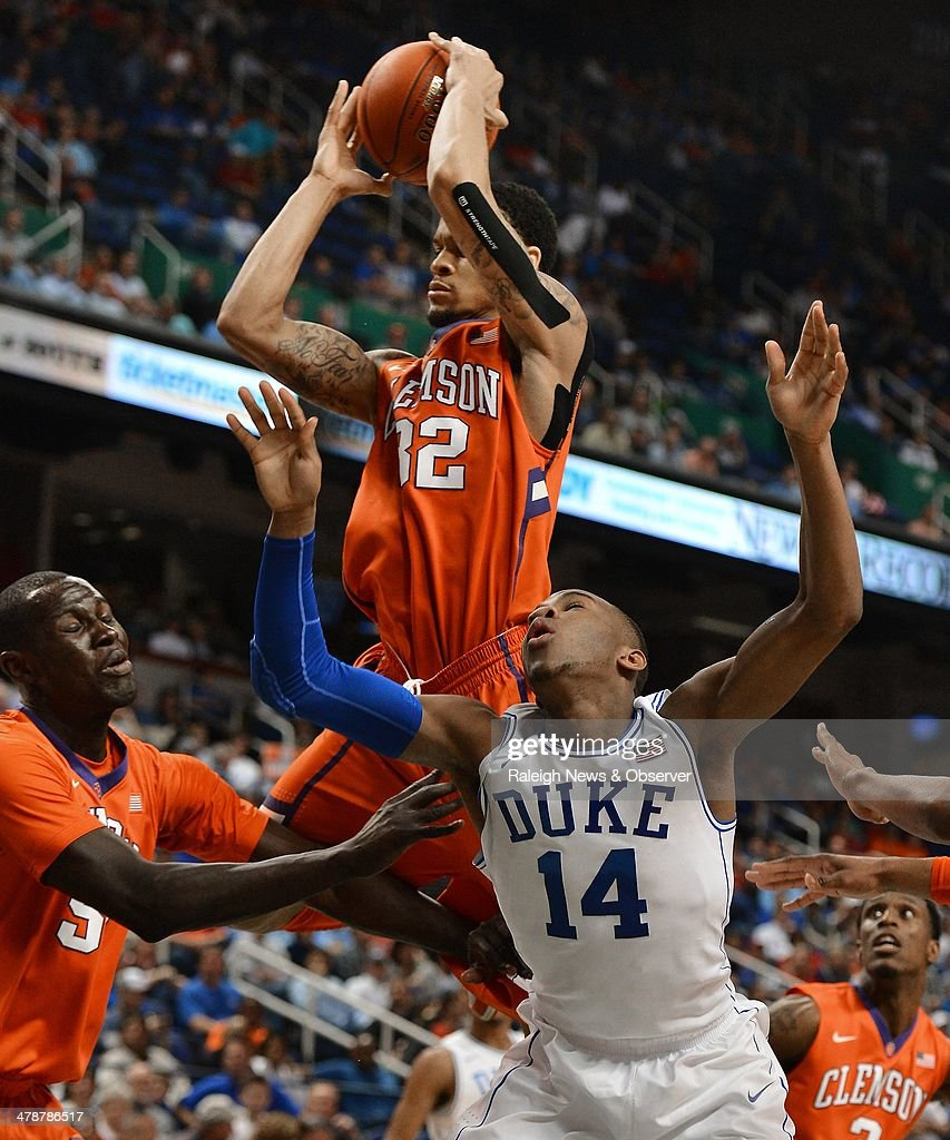 Clemson's K.J. McDaniels (32) rips a rebound from Duke's Rasheed Sulaimon (14) in the second half in the ACC Tournament quarterfinals at the Greensboro Coliseum in Greensboro, N.C., Friday, March 14, 2014. Duke advance, 63-62.