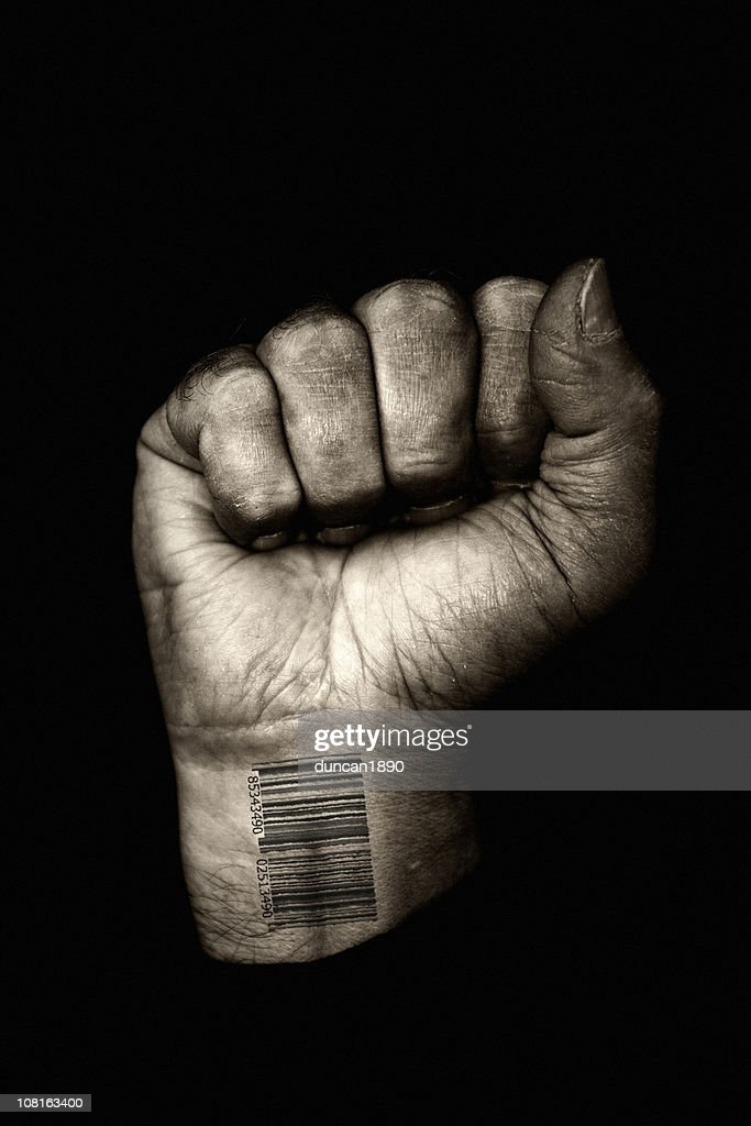 Clenched Fist with Barcode on Wrist, Toned : Stock Photo
