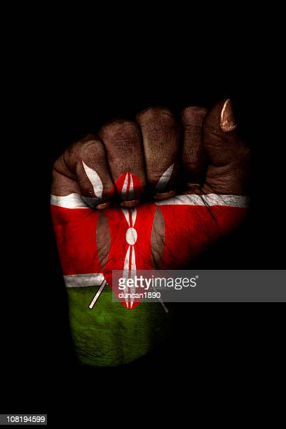 Clenched Fist with Kenyan Flag Painted, Isolated on Black