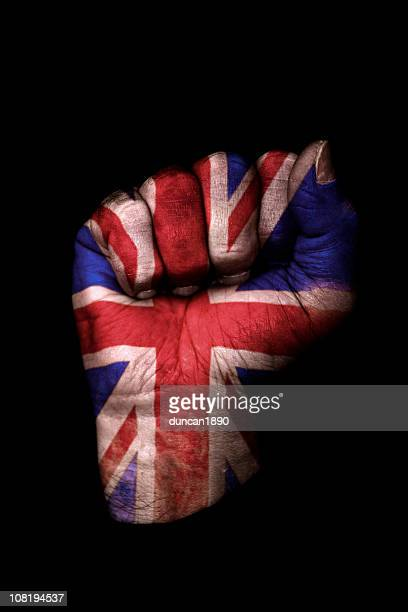 Clenched Fist with Union Jack Flag Painted, Isolated on Black