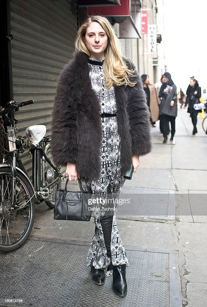 Cleo Davis, editor at Moda Operandi from New York, is seen wearing Theyskeyns Theory coat, vintage skirt, Alexander Wang leggings and Balenciaga bag on February 6, 2013 in New York City.