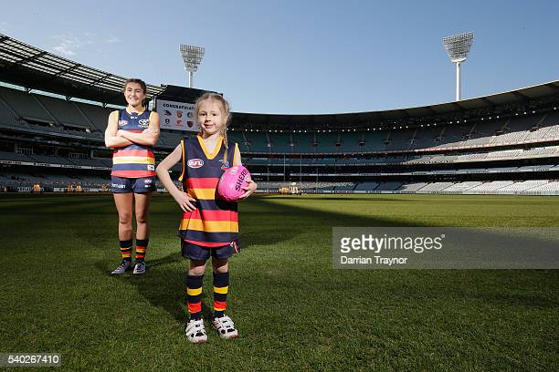 Cleo Faulks and Bella Cooper pose for a photo wearing the Adelaide Crows jumpers during an AFL media opportunity to announce the competing teams in...
