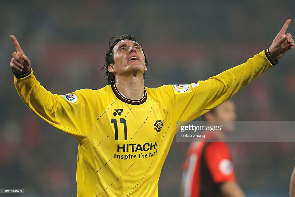 Cleo of Kashiwa Reysol celebrates scoring their first goal during the AFC Champions League match between Guizhou Renhe and Kashiwa Reysol at Olympic Sports Center on February 27, 2013 in Guiyang, China.