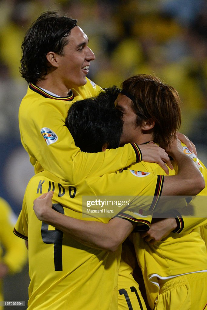 Cleo #11 of Kashiwa Reysol (L) celebrates the first goal during the AFC Champions League Group H match between Kashiwa Reysol and Guizhou Renhe at Hitachi Kashiwa Soccer Stadium on April 23, 2013 in Kashiwa, Japan.
