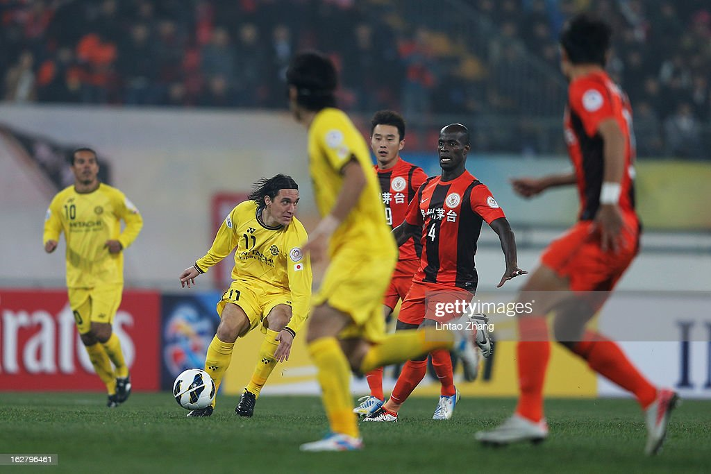 Cleo (2nd-L) of Kashiwa Reysol controls the ball during the AFC Champions League match between Guizhou Renhe and Kashiwa Reysol at Olympic Sports Center on February 27, 2013 in Guiyang, China.