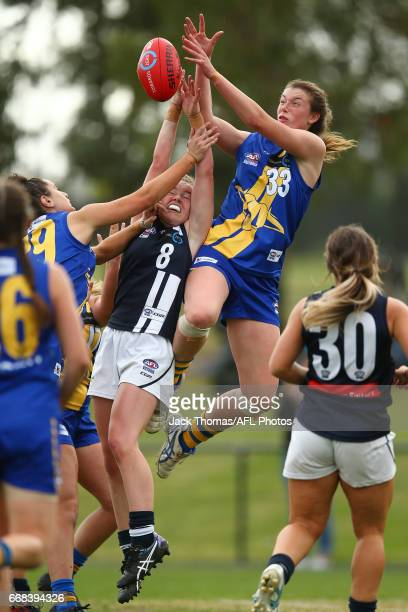 Cleo SaxonJones of the Western Jets attempts to mark the ball during the TAC Cup Girls round five match between the Western Jets and Geelong Falcons...
