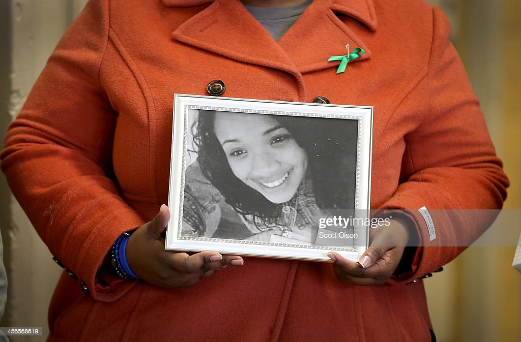 Cleopatra Cowley-Pendleton holds a picture of her daughter Hadiya, 15, during a gathering of gun violence victims and gun control advocates at Cornell Square Park on the anniversary of the Sandy Hook Elementary School shooting December 14, 2013 in Chicago, Illinois. Thirteen people, including a three-year-old boy, were wounded when gunmen opened fire on a crowd gathered at the basketball courts in Cornell Square Park in September. Twenty children and 6 adults were killed when a gunman opened fire at Sandy Hook School. Hadiya was shot and killed while hanging out with friends in a park after school on January 29, 2013, one week after performing at President Barack Obama's second inauguration. Hadiya is 1 of more than 400 people who have been murdered in Chicago so far this year, most by gunfire.