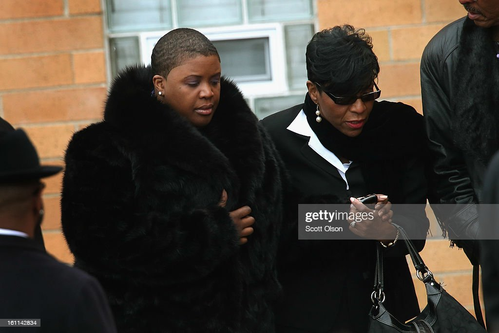 Cleopatra Pendleton (L) arrives for the funeral of her 15-year-old daughter Hadiya at the Greater Harvest M.B. Church on February 9, 2013 in Chicago, Illinois. Hadiya was killed on January 29, when a gunman opened fire on her and some friends while they were standing under a shelter on a warm rainy afternoon in a park about a mile from President Obama's Chicago home. First lady Michelle Obama attended the funeral with Senior White House Adviser Valerie Jarrett and Secretary of Education Arne Duncan.