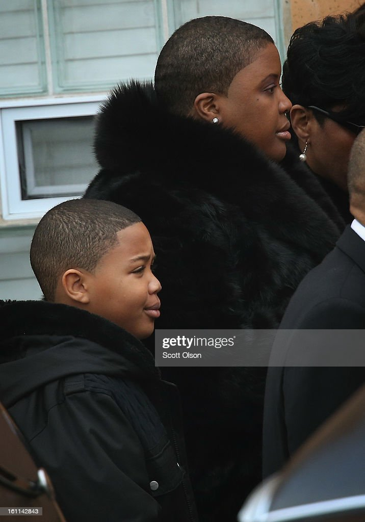 Cleopatra Pendleton arrives with her son Nathaniel for the funeral of her 15-year-old daughter Hadiya at the Greater Harvest M.B. Church on February 9, 2013 in Chicago, Illinois. Hadiya was killed on January 29, when a gunman opened fire on her and some friends while they were standing under a shelter on a warm rainy afternoon in a park about a mile from President Obama's Chicago home. First lady Michelle Obama attended the funeral with Senior White House Adviser Valerie Jarrett and Secretary of Education Arne Duncan.