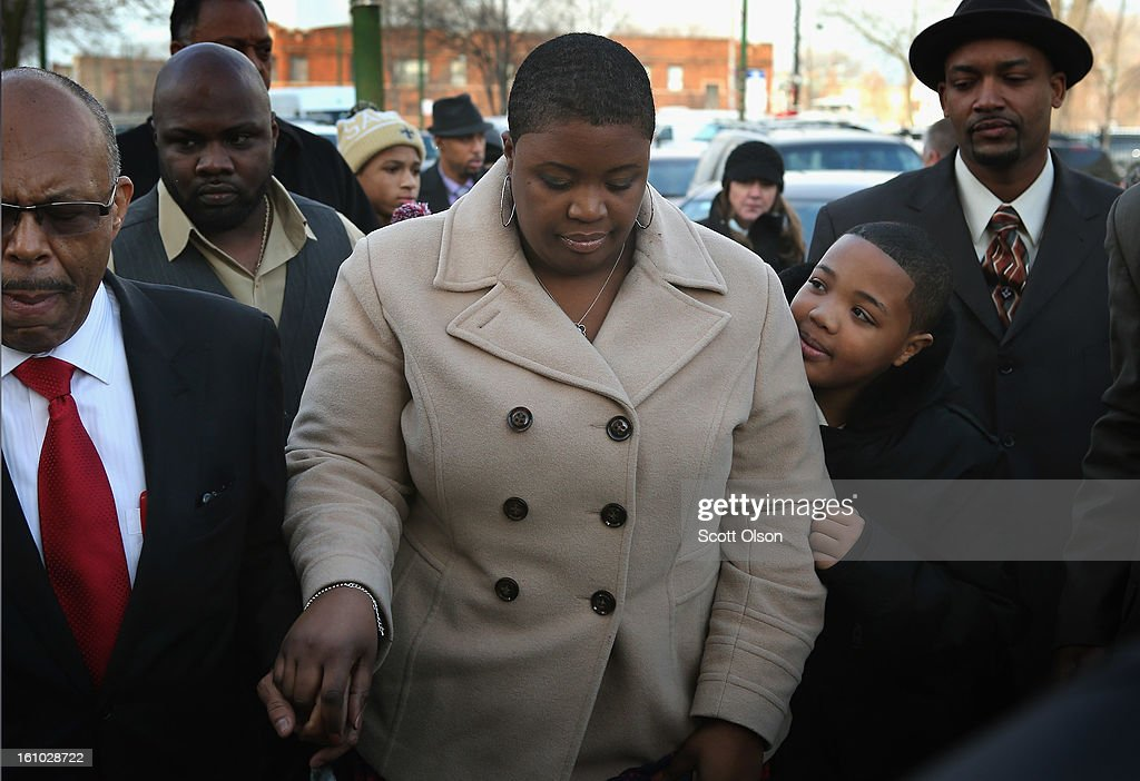 Cleopatra Pendleton arrives with her son Nathaniel for the wake of her 15-year-old daughter Hadiya Pendleton at the Calahan Funeral Home on February 8, 2013, in Chicago, Illinois. Hadiya was killed when a gunman opened fire on her and some friends as they stood under a shelter on a warm, rainy afternoon in a park about a mile from President Obama's Chicago home. First lady Michelle Obama is expected to attend tomorrow's funeral with senior White House adviser Valerie Jarrett and Secretary of Education Arne Duncan.