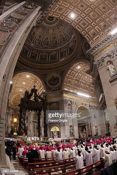 Clergy and the faithful gather as Pope Francis holds the Holy Saturday Easter vigil mass at St Peter's Basilica on March 30 2013 in Vatican City...