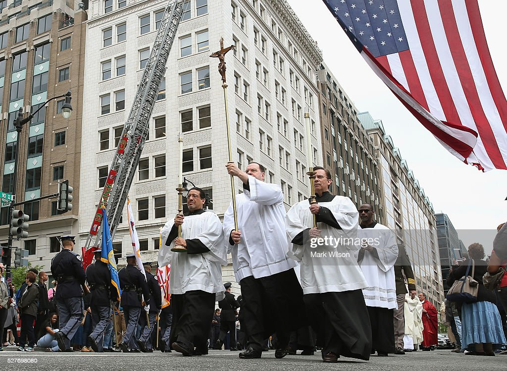 Clergy from St. Patrick's Catholic Church participate in the 22nd annual 'Blue Mass' at May 3, 2016 in Washington, DC. The mass is held by the National Law Enforcement Officers Memorial Fund to recognize the first responders who have given their lives in the past year.