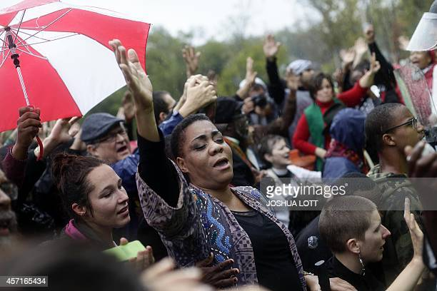 Clergy members and demonstrators protest the shooting of Michael Brown outside the Ferguson Police Station October 13 2014 in Ferguson Missouri Civil...