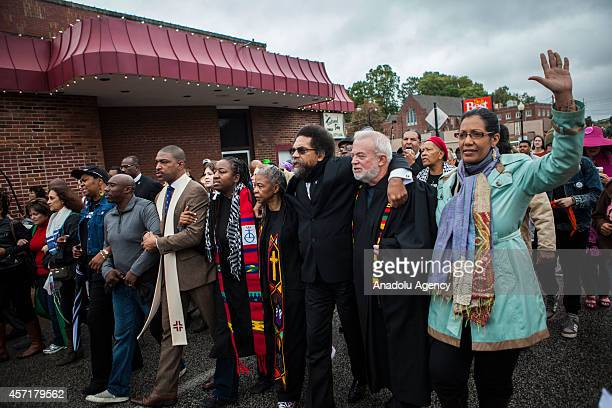 Clergy members lead hundreds of protestors march from Wellspring Church to the Ferguson police station in an act of civil disobedience on October 13...
