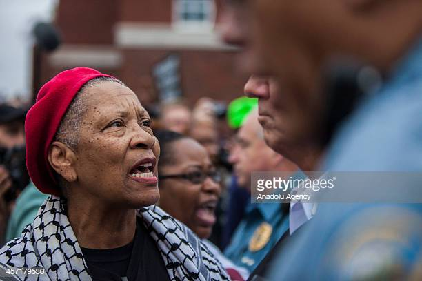 Clergy members speak with senior Police officers in front of the Ferguson police station on October 13 2014 in Ferguson Missouri The protests are...