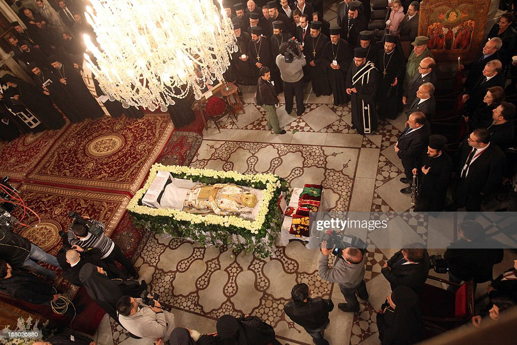 Clergy stand around the body of Greek Orthodox Patriarch of Syria Ignatius IV Hazim, is layed out at the Mariamite Cathedral of Damascus, on December 9, 2012. Patriarch Hazim died in neighboring Beirut, Lebanon, of a stroke on December 5, and his body has been taken to Syria for burial on December 10.