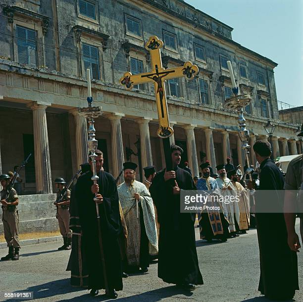 Clergyman pass the Palace of St Michael and St George in Corfu City Corfu Greece during the festival of Saint Spyridon circa 1965 Spyridon is the...