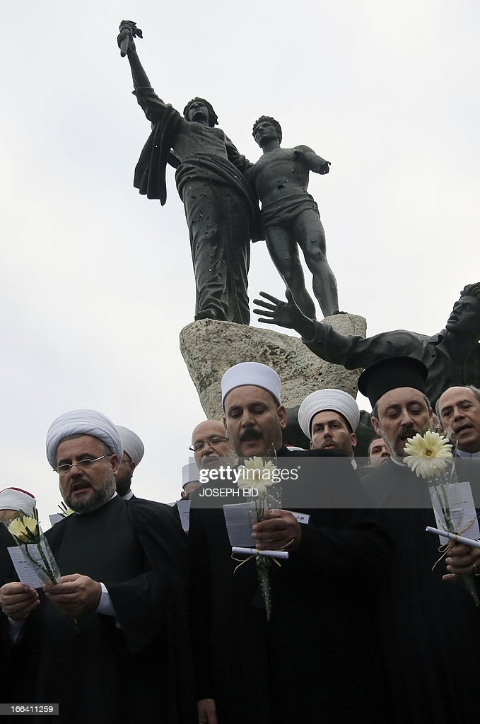 Clerics representing the various Lebanese religious communities pray together in central Beirut on the eve of the anniversary of the 1975-1990 civil war on April 12, 2013.
