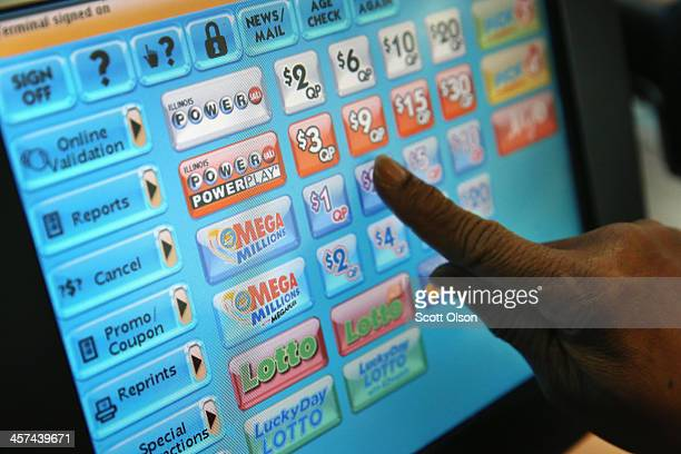 A clerk prints a Mega Millions lottery ticket at a convenience store on December 17 2013 in Chicago Illinois The jackpot is currently the second...