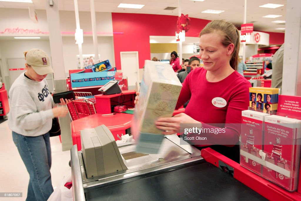 A clerk rings up sales for a customer at a Target store November 30 2004 in Chicago Illinois High oil prices and a weak economy have retailers...