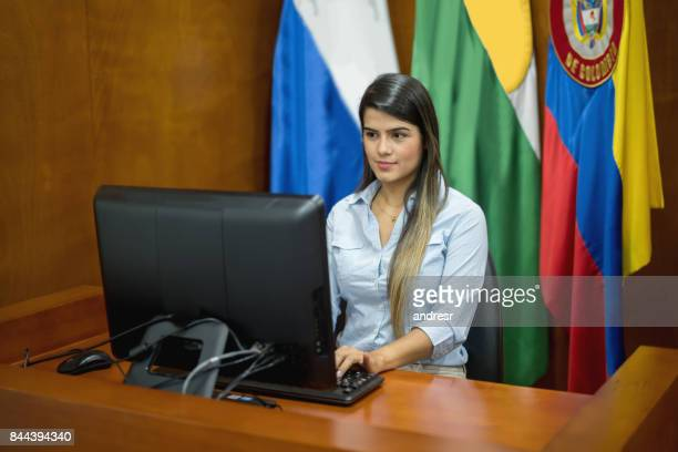 Clerk working at the courtroom typing the session