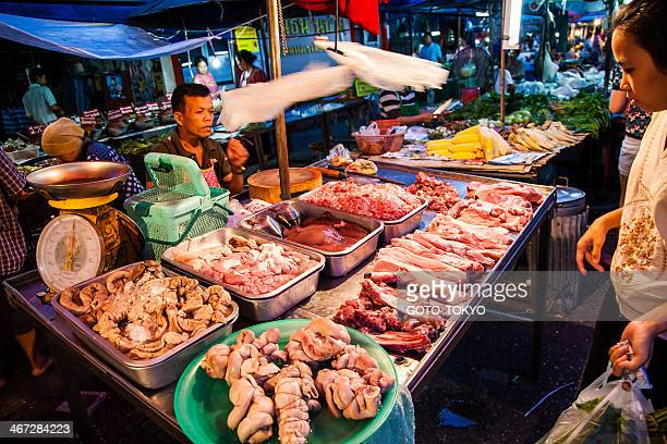 Clerks selling raw meat at the night market