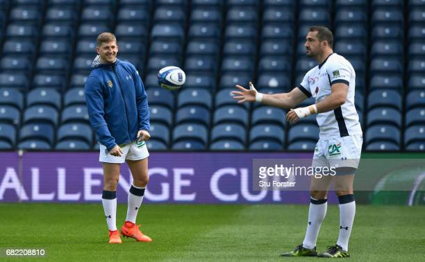 Clermont Auvergne wing David Strettle shares a joke with Scott Spedding during the captains run before the 2017 European Rugby Champions Cup Final at...