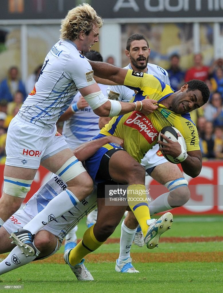Clermont Fijian winger Napolioni Nalaga (R) is tackled by Castres Scottish lock Richie Gray (L) during the Top 14 play-off quarter final rugby union match ASM Clermont vs Castres Olympique at the Michelin stadium in Clermont-Ferrand, central France, on May 10, 2014.