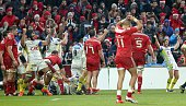 Clermont players celebrate their win at the final whistle in the European Champions Cup rugby union match between Munster and ASM Clermont Auvergne...