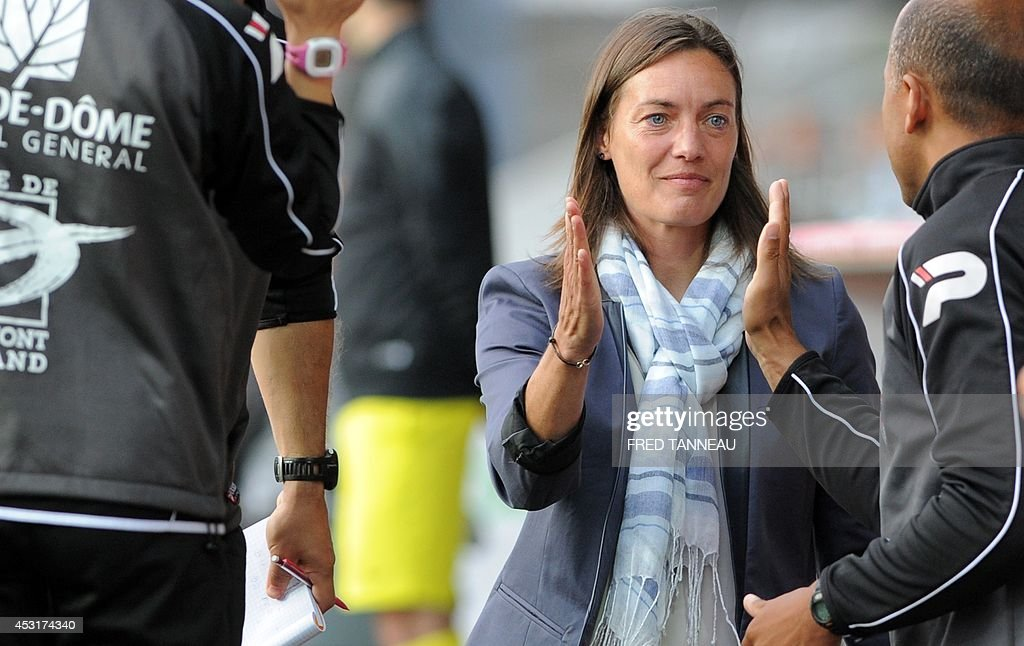 Clermont-Ferrand's French coach Corinne Diacre congratulates her staff after her team scored during the French L2 football match between Brest and Clermont-Ferrand on August 4, 2014 at the Francis Le Ble stadium in Brest, western France. Diacre is the first woman to lead a men's professional team in a major European country. Diacre was hired after Clermont's original choice, another woman, Portuguese Helena Costa, resigned abruptly the day before taking charge of the team.