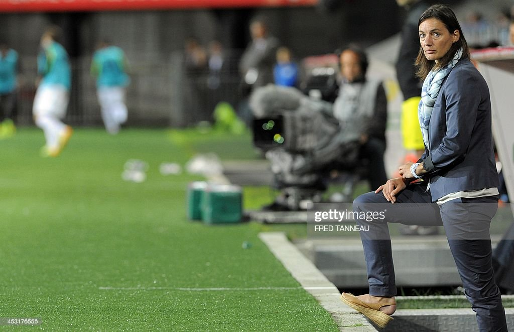 Clermont-Ferrand's French coach Corinne Diacre looks on during the French L2 football match between Brest and Clermont-Ferrand on August 4, 2014 at the Francis Le Ble stadium in Brest, western France. Diacre is the first woman to lead a men's professional team in a major European country. Diacre was hired after Clermont's original choice, another woman, Portuguese Helena Costa, resigned abruptly the day before taking charge of the team.