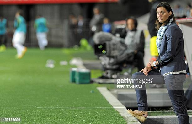 ClermontFerrand's French coach Corinne Diacre looks on during the French L2 football match between Brest and ClermontFerrand on August 4 2014 at the...