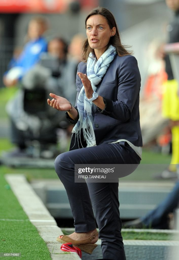 Clermont-Ferrand's French coach Corinne Diacre reacts during the French L2 football match between Brest and Clermont-Ferrand on August 4, 2014 at the Francis Le Ble stadium in Brest, western France. Diacre is the first woman to lead a men's professional team in a major European country. Diacre was hired after Clermont's original choice, another woman, Portuguese Helena Costa, resigned abruptly the day before taking charge of the team.