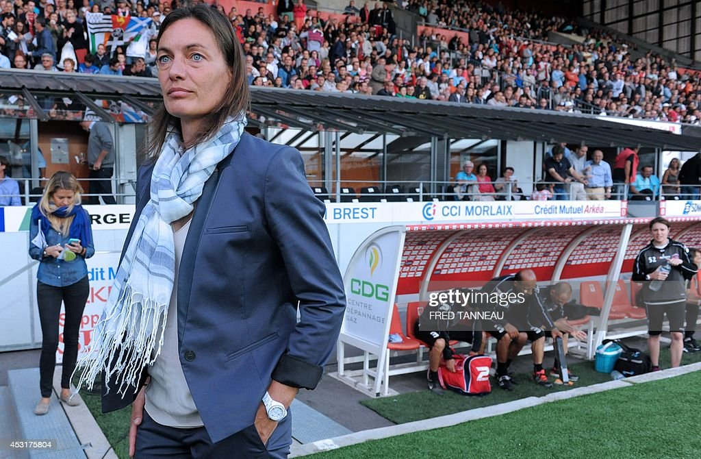 Clermont-Ferrand's French coach Corinne Diacre stands during the French L2 football match between Brest and Clermont-Ferrand on August 4, 2014 at the Francis Le Ble stadium in Brest, western France. Diacre is the first woman to lead a men's professional team in a major European country. Diacre was hired after Clermont's original choice, another woman, Portuguese Helena Costa, resigned abruptly the day before taking charge of the team.