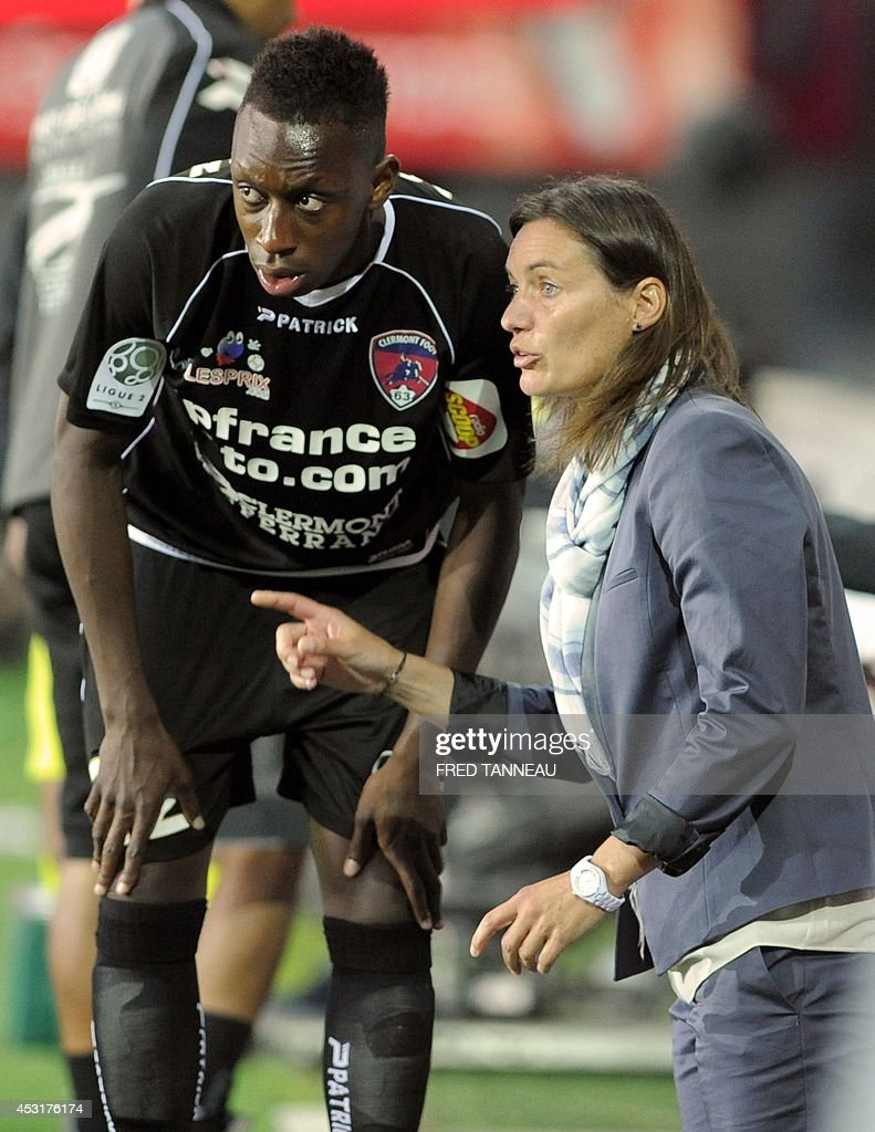 Clermont-Ferrand's French coach Corinne Diacre (R) talks with Clermont-Ferrand's midfielder Brandon Agounon during their French L2 football match against Brest on August 4, 2014 at the Francis Le Ble stadium in Brest, western France.