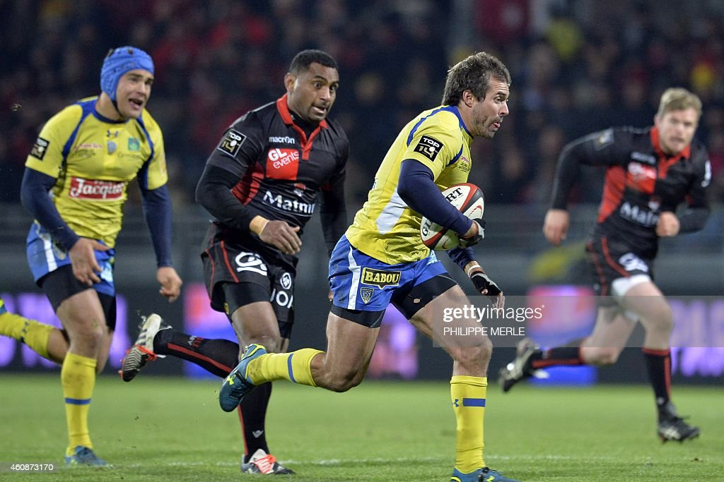 Clermont's Australian fly-half <a gi-track='captionPersonalityLinkClicked' href=/galleries/search?phrase=Brock+James&family=editorial&specificpeople=636412 ng-click='$event.stopPropagation()'>Brock James</a> runs with the ball during the French Top 14 rugby union match between Lyon (LOU) Vs Clermont (ASM) on December 28, 2014 in Lyon.