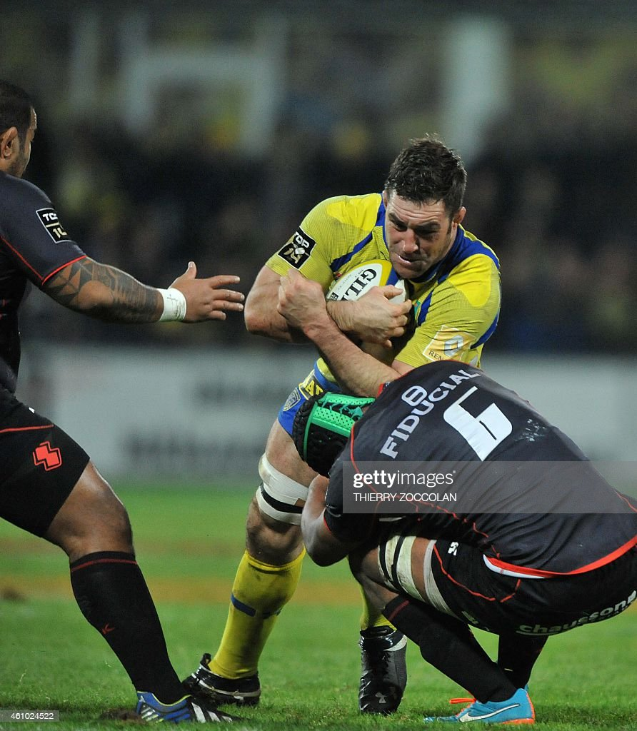 Clermont's Canadian lock <a gi-track='captionPersonalityLinkClicked' href=/galleries/search?phrase=Jamie+Cudmore&family=editorial&specificpeople=2160348 ng-click='$event.stopPropagation()'>Jamie Cudmore</a> (C) is tackled by Toulouse's players during the French Union Rugby match ASM Clermont vs ST Toulouse at the Michelin stadium in Clermont-Ferrand, central France, on January 04, 2015.