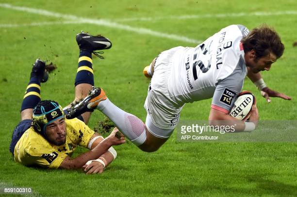 Clermont's centre Atila Septar tackles Toulouse's wing Maxime Medard during the French Top 14 rugby union match Stade Toulousain vs Clermont Auvergne...