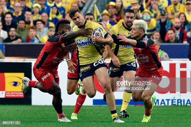 Clermont's centre Damien Penaud is tackled by Toulon's centre Mathieu Bastareaud during the French Top 14 rugby union final match Clermont vs Toulon...