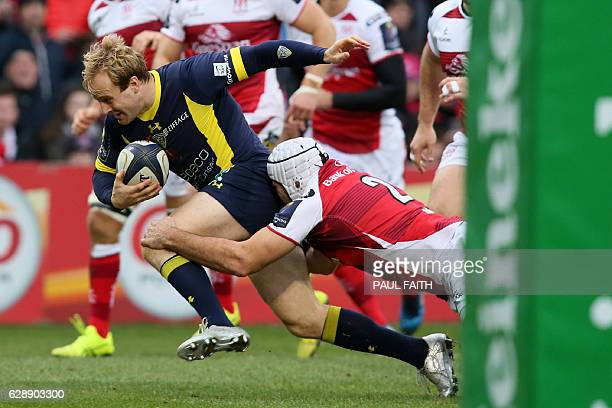 Clermont's English wing Nick Abendanon is tackled by Ulster's Irish hooker Rory Best during the European Rugby Champions Cup rugby union match...