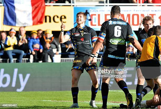 Clermont's English winger David Strettle celebrates after scoring a try during the European Champions Cup rugby match Clermont vs Ospreys at the...
