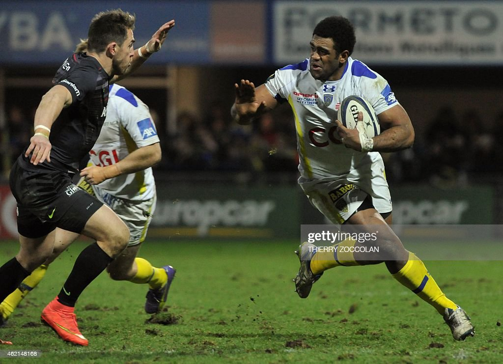 Clermont's Fidji winger <a gi-track='captionPersonalityLinkClicked' href=/galleries/search?phrase=Napolioni+Nalaga&family=editorial&specificpeople=4067717 ng-click='$event.stopPropagation()'>Napolioni Nalaga</a> (R) holds the ball during the European Champions Cup rugby union match Clermont vs Saracens at the Michelin stadium in Clermont-Ferrand, central France, on January 25, 2015. AFP PHOTO / THIERRY ZOCCOLAN